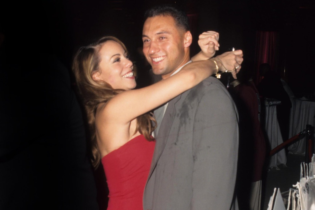 Baseball player Derek Jeter with singer Mariah Carey at rapper Puff Daddy's birthday gala at Cipriani Rest, in New York in 1998. (Credit Image: © John Barrett/Globe Photos)